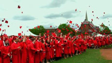 clip from film trailer - graduates throwing mortarboards in the air